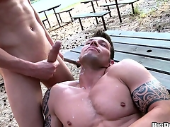 Two buff studs have bareback anal sexual affinity out in a reprobate beach