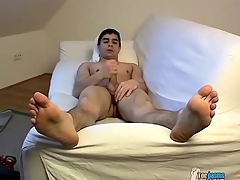 Unveil young brunette panhandler jerks off his cock