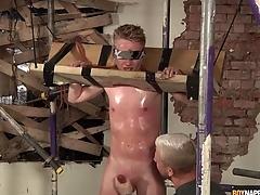 Sweaty boy anent bondage gets a hot handjob