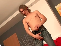 Stripping young man with long hair is off colour